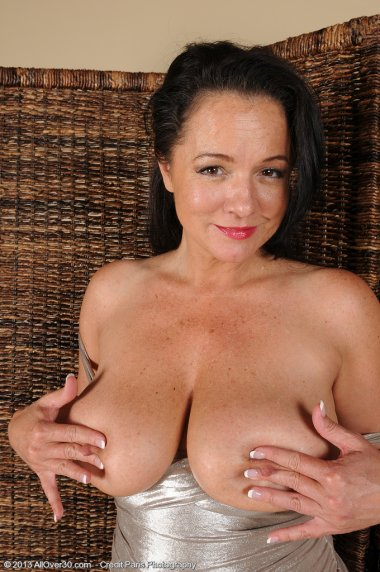 Brunette mature woman shows off her pink pussy