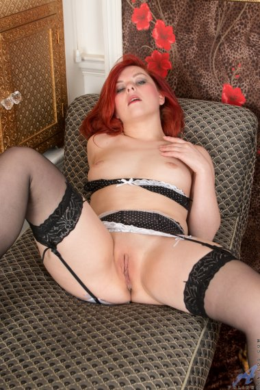 Redhead horny housewife shows off her pink shaved pussy