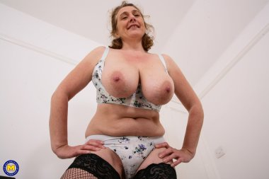 Naughty British housewife showing off her big tits