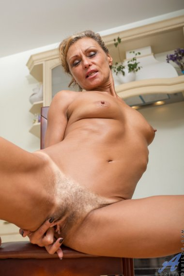 Hot MILF shows off her hairy pussy in the kitchen