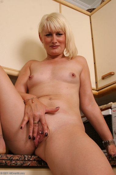 41 year old MILF strips and displays a pierced and shaved pussy
