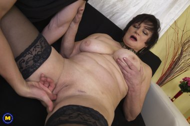 Curvy housewife playing with her younger lover