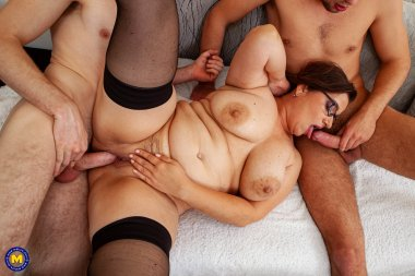 This curvy big breasted teacher takes on two of her students for sex