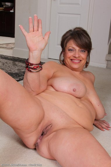 Cute 48 year old Penny Beavers spreads her mature legs for the camera